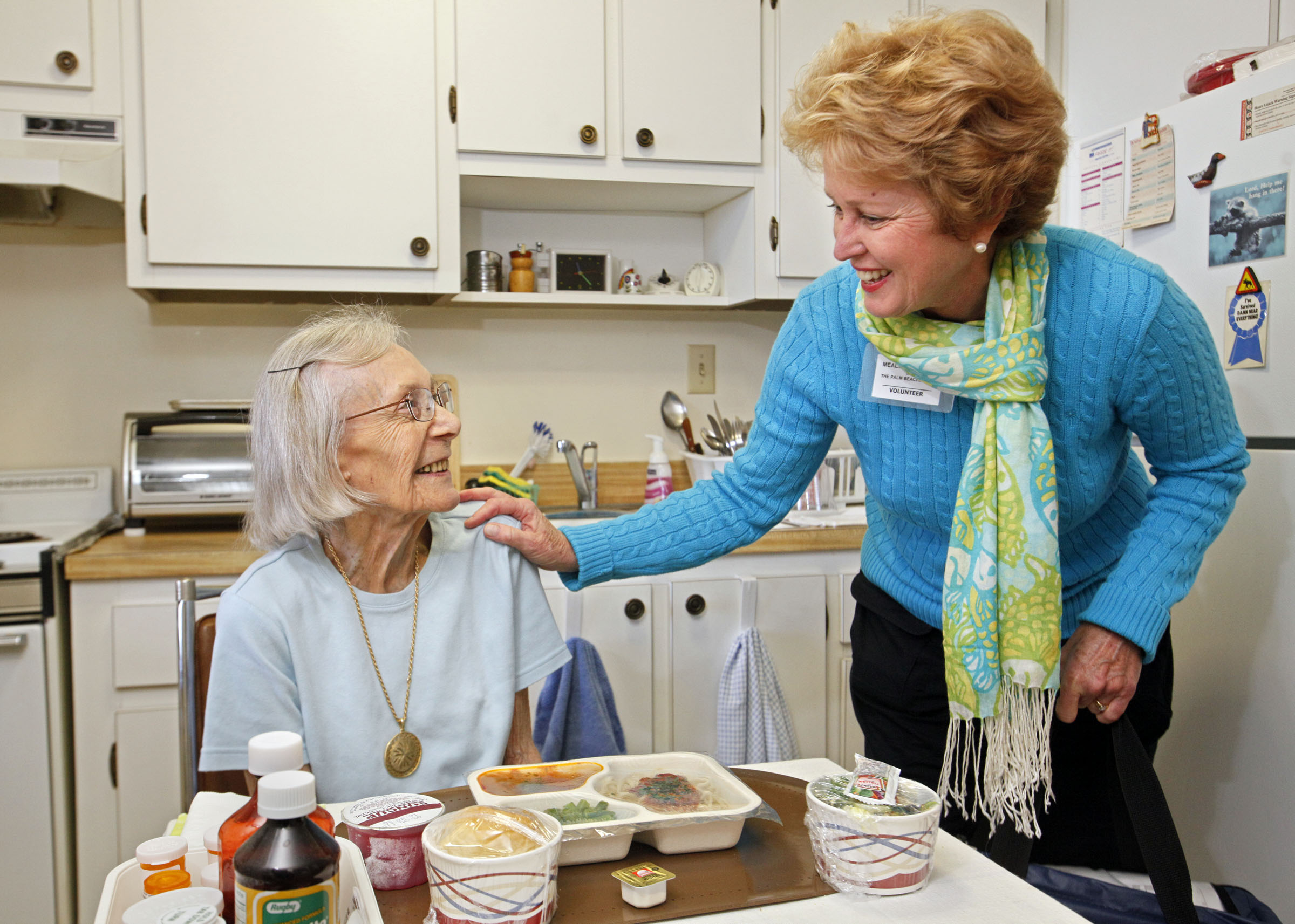 031111   (Lannis Waters/The Palm Beach Post) WEST PALM BEACH  -- Meals on Wheels of the Palm Beaches volunteer Patty Ring (cq)(right) chats with Elma Hatch (cq) after delivering a meal to her Friday morning.  The county finally has an official Meals on Wheels program, affiliated with the national program.
